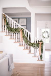 staircase with holiday garland and bows