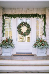 Front door with planter boxes cedar rope and large wreath