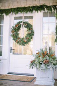 front door with cedar rope, winter planter box and wreath