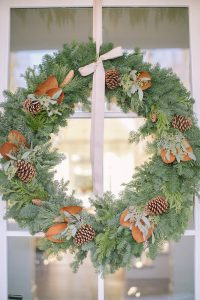 wreath with bow and magnolia on front door