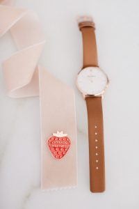 Watch with ribbon beside
