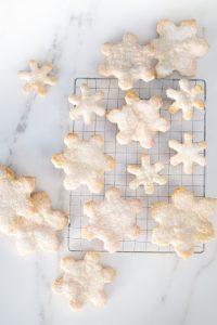 snowflake cookies on cooling rack on mabel countertop