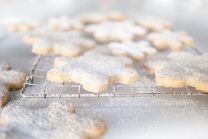 close up of snowflake cookies dusted with icing sugar