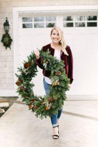 women walking with wreath