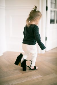 little girl in moms heels