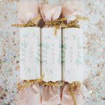 three christmas crackers, glitter around