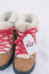 Gifts in snow with red laces and gift tag