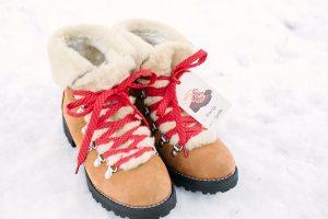 boots in the snow with red laces