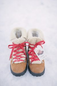 boots is snow with gift tag and red laces