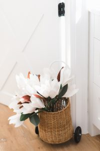 small wicker basket with paper magnolia flowers