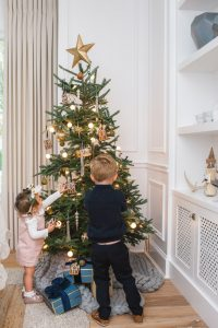 little boy and girl decorating tree