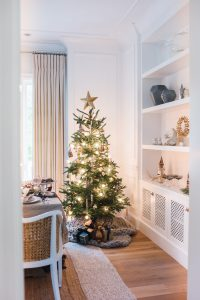 small christmas tree in white dinning room corner