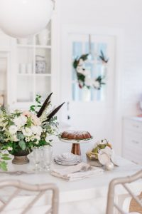 island with christmas floral arrangement and bundt cake