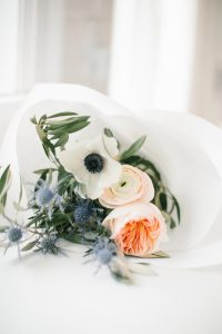 fresh florals wrapped in white paper