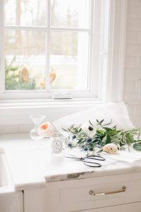 kitchen counter, window florals and vases