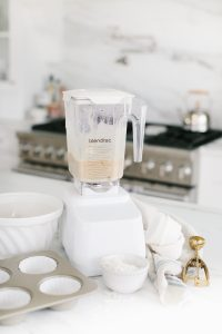 white blender, ingredients in white kitchen