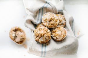 over head of muffins in cream tin with french linen napkin