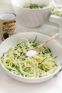 zucchini noddles in pan with coconut cream