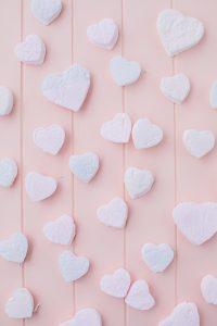 heart shaped marshmallows on pink board