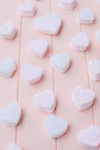 heart shaped marshmallows on pink board