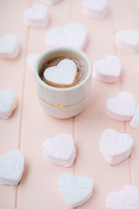 heart marshmallows on pink cutting board