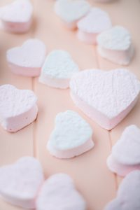 heart marshmallows on pink board