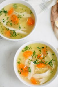 two bowls of chicken noodle soup