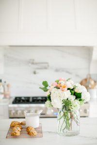 florals and scones in bright white kitchen