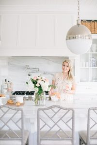 Women in bright airy kitchen