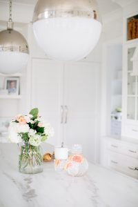 large white kitchen, marble and built in fridge