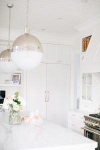 bright white kitchen, built in fridge