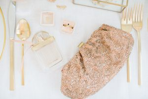 pink clutch , gold cutlery, chloe fragrance