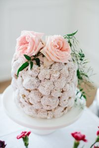 cream puff cake on cake stand florals on top