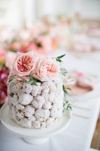Cream puff cake on white cake stand
