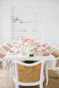 Dinning room set with beautiful table and florals