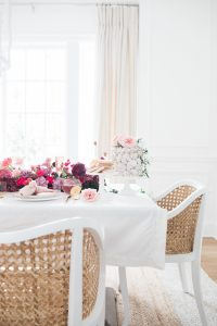 Table scape with beautiful flowers and cake