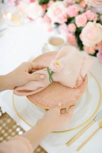setting table with pink blush napkins