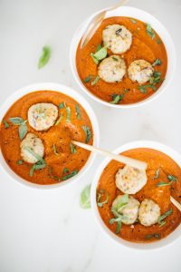 Turkey meatballs in coconut tomato bisque soup with fresh basil