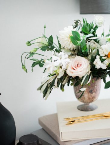 Floral arrangement on books