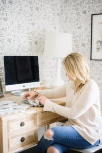 Girl sitting at pretty wooden desk in office