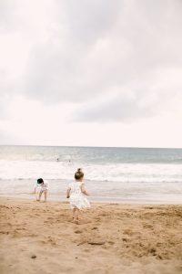 little boy and girl running on Hawaiian beach