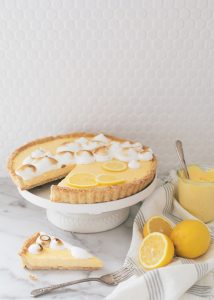 lemon curd tart on cake stand