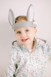 little girl with bunny ear headband