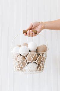 paper mâché eggs in basket