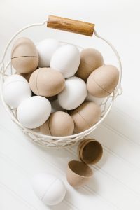 paper easter eggs in white basket