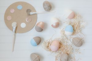flat lay paper easter eggs and raffia