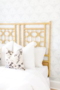 layered pillows whites and floral pattern