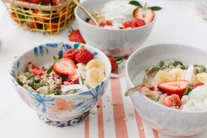 pretty oats in a bowl with floral garnish