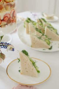 cucumber sandwhich on gold rimmed plate