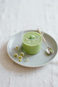 green panna cotta with daisies